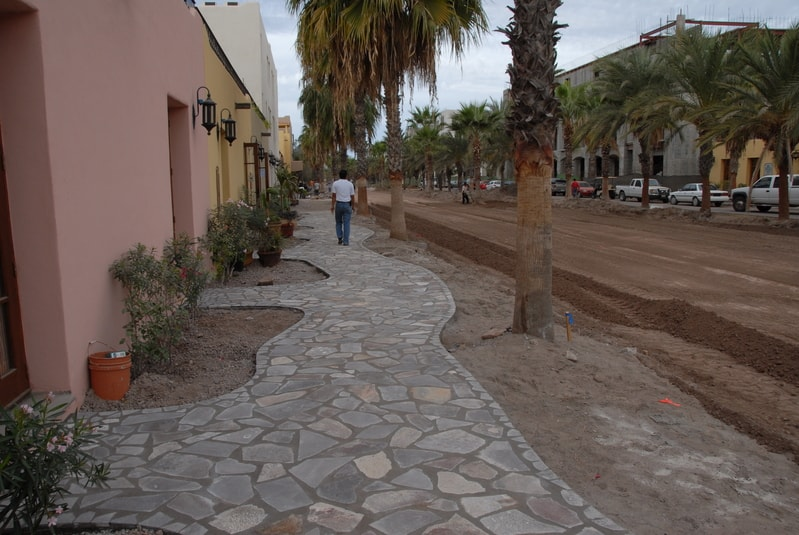 There are the winding walking paths along the Paseo. Will be nice and also provide permeable surfaces for water to flow in heavy rains.