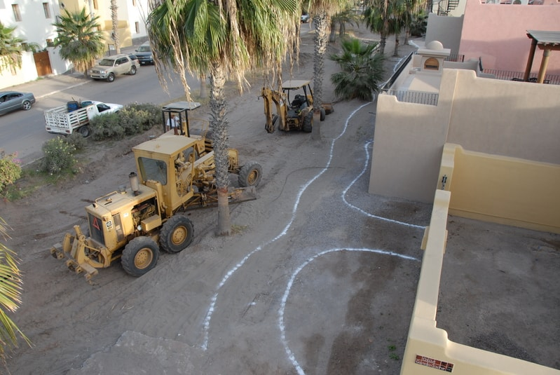 Chalk lines drawn for the planning of where the winding paths will go.