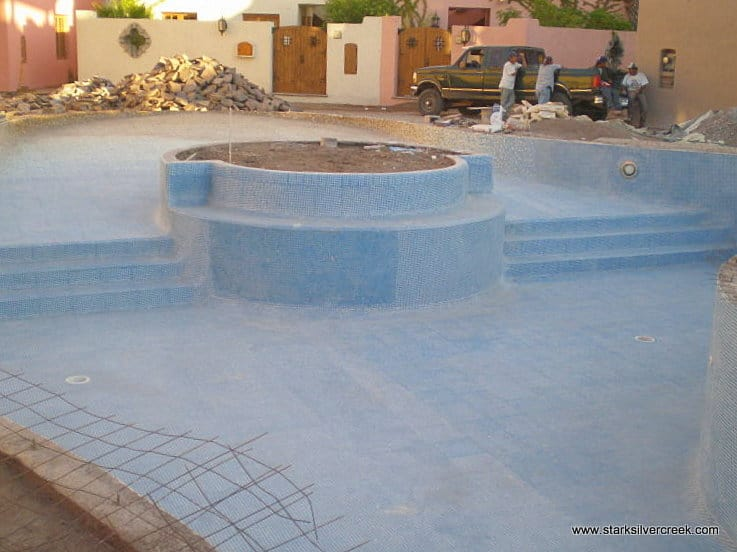 The tile work on the pool seems near complete. Will be beautiful when filled with water. I wonder if they will put the tree back in the center circle. I hope so as I think it will make for a dramatic effect.
