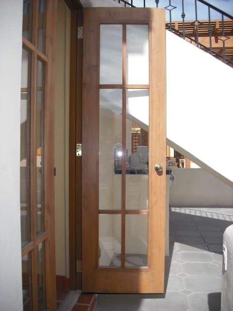 """I had a question on the french doors and windows. When I saw these on our last visit down in Loreto, I was concerned because the wood strips was only on the outside of the doors. They have been fixed so that both sides now have the wood strips. I did noticed the door handles are knobs, not levers. I really hope the knobs are temporary construction knobs and will be replaced with the """"real"""" ones when the home is turned over."""