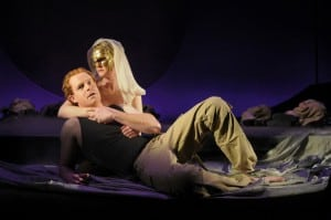 Sea nymph Thetis (René Augesen) comforts her son and Greek hero Achilles (Jud Williford) in her arms.  Production photos by Kevin Berne