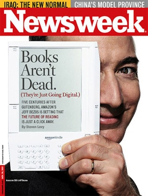 Jeff Bezos with the first generation Kindle, savior to the newspaper industry?