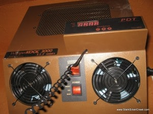 Retro brown styling with switches and LED readouts: It's the Dr. No James Bond wine cellar!