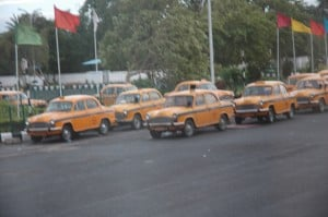 These taxis look like they were out of the 1950s or Cuba or a rip in the time-space continuum