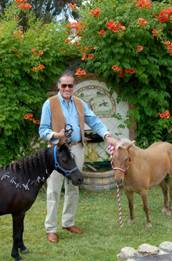 Sergio Traverso, Co-founder of Murrieta's Well Winery, stands in front of  Joaquin Murrieta's Artesian Well with Blackie and Allie, Therapy Horses from the SonRise Equestrian Foundation