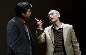 Playwright D.H.H. (Pun Bandhu, left) takes a lesson on the American dream from his father, H.Y.H. (Francis Jue, right) in the Bay Area premiere of YELLOW FACE at TheatreWorks.  Photo Credit: Mark Kitaoka