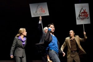 "Marcus ""Gee"" Dahlman (Thomas Azar, center) leads protestors (Amy Resnick, left, Howard Swain, center back, and Francis Jue, right) supporting Asian American rights in the Bay Area premiere of YELLOW FACE at TheatreWorks.  Photo Credit: Tracy Martin"