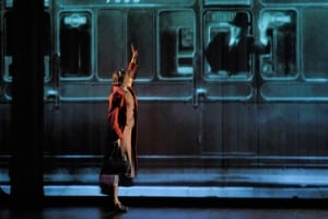 Kneehigh Theatre's acclaimed production of Brief Encounter melds theater and film in unexpected ways: Laura (Hannah Yelland) waves goodbye to Alec (Milo Twomey) as he leaves on his train. Photo by Kevin Berne.