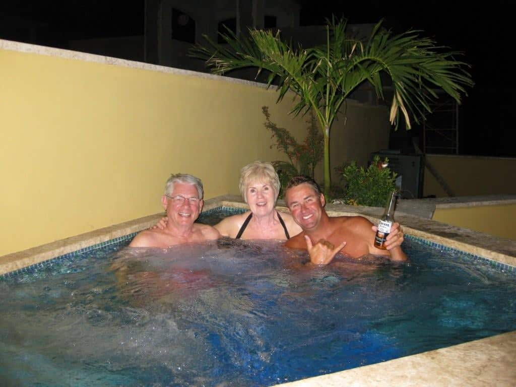 Bill and Julie Thompson enjoy with Greg Gordon their first soak in their new solar heated hot tub!