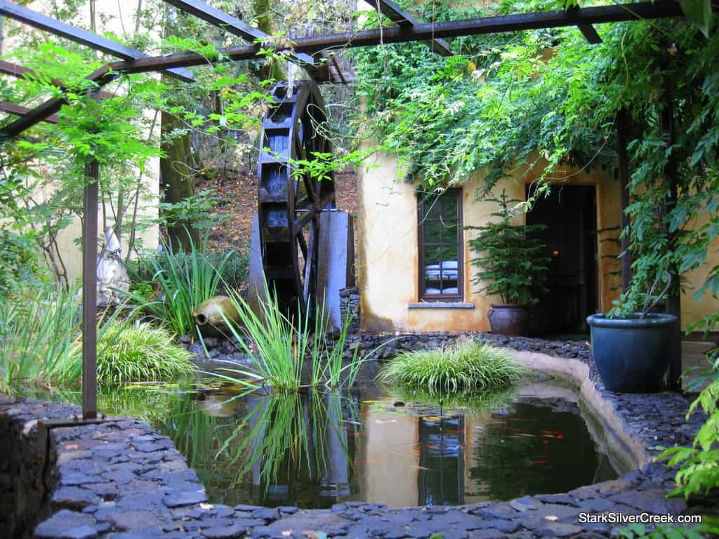 Water wheel. Behind, a secluded hot tub and steam shower for romantic interludes. I plead the fifth.