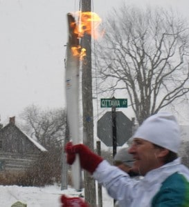 Olympic Torch Bearer, Brian Carty, runs 300m leg of the relay in the town of Almonte.
