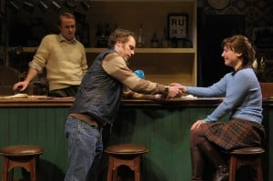 The Weir 8: (l to r) Brendan (Alex Moggridge) holds back tears as Jim (Mark Anderson Phillips) consoles Valerie (Zillah Glory) in San Jose Repertory Theatre's production of The Weir.
