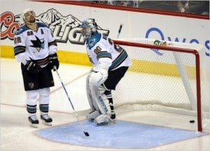 Dan Boyle and Evgeni Nabakov react after own goal.