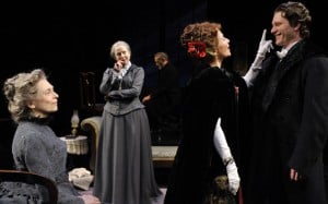 John Gabriel Borkman (c, James Carpenter) paces in the attic as Ella (l, Karen Lewis) and Gunhild (c. left, Karen Grassle) entertain Mrs. Wilton (c. right, Pamela Gaye Walker) and Erhart Borkman (r, Aaron Wilton) in John Gabriel Borkman  Photo by David Allen