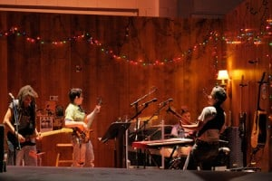 At Berkeley Rep, a rocking four-piece band supports the world premiere of Girlfriend: (l to r) Shelley Doty on lead guitar, Jean DuSablon on bass, ieela Grant on drums and Julie Wolf on rhythm guitar and keyboards. Photo courtesy of kevinberne.com