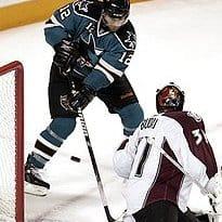 San Jose Sharks center Patrick Marleau (12) scores past Colorado Avalanche goalie Peter Budaj (31), of Slovakia, in the third period of Game 5 of a first-round NHL hockey playoff series Thursday, April 22, 2010, in San Jose, Calif. (AP Photo/Paul Sakuma) (Paul Sakuma - AP)