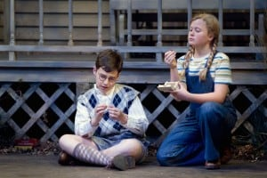 L-R Dill (Gabriel Hoffman) and Scout (Sierra Stephens) inspect a couple of pennies they found in the knothole of a  tree in Christopher Sergel's adaptation of Harper Lee's  timeless American classic, TO KILL A MOCKINGBIRD  at TheatreWorks.  Photo Credit Mark Kitaoka