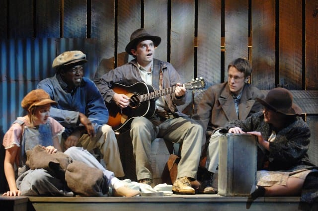 Photo by Glenn Asakawa Megan Smith, Daver Morrison, Sam Misner as Woody Guthrie, Matthew Mueller and Lisa Asher in Woody Guthrie's American Song. Photo by courtesy of the Colorado Shakespeare Festival.