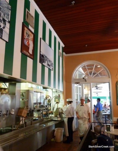 The corridor to the outside is always bustling with waiters carrying plates of Beignets and filling cups with coffee and Cafe Au Lait.