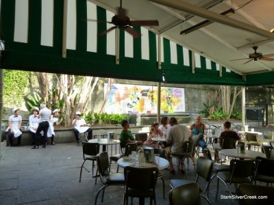 Cafe du Monde has a large outdoor eating area covered by the well-recognized white and green striped awning.