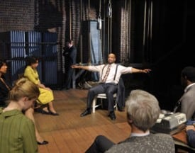 Sheldon (c. Rhonnie Washington*) recalls a lynching as cast and crew (clockwise from r, Jon Gentry*, Patrick Russell*, Tim Kniffin*, Melissa Quine, Elizabeth Carter*, Margo Hall*, Michael Ray Wisely*) look on in Trouble in Mind Photo by David Allen