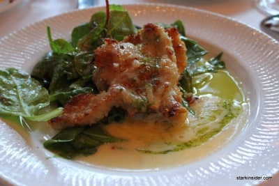 Abalone in a butter sauce with wilted greens. Very tastefully prepared.