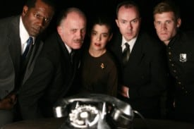 Whatever you do..don't answer the phone! The cast of Hillbarn Theatre's Dial M for Murder includes (from left to right) Fred Pitts (Max Halliday), Steve Schwartz Inspector Hubbard), Kelly Rinehart (Margot Wendice), Frederick Goris (Tony Wendice) , and Max Reinhardt (policeman Thompson).
