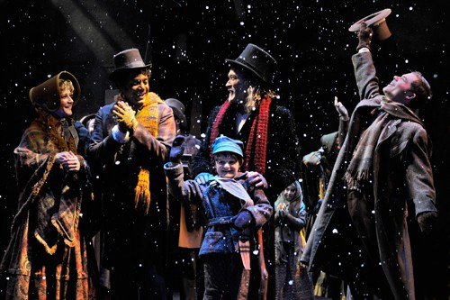 A reformed Scrooge (James Carpenter, center) celebrates the season with his nephew, Fred (A.C.T. Master of Fine Arts Program student Philip Mills, right), and the Cratchits: Bob (A.C.T. core acting company member Gregory Wallace), Anne (A.C.T. core acting company member René Augesen), and Tiny Tim (Calum John). Production photos by Kevin Berne (www.kevinberne.com)