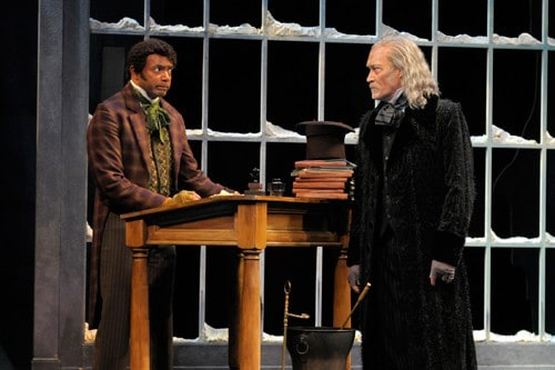 Ebenezer Scrooge (James Carpenter, right) scolds his overworked employee Bob Cratchit (A.C.T. core acting company member Gregory Wallace) on Christmas Eve. Production photos by Kevin Berne (www.kevinberne.com).