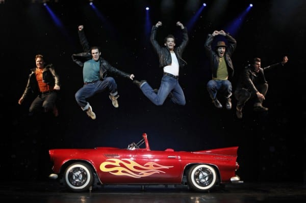 "Brad Lawson as ""Roger,"" Marc Winski as ""Doody,"" Patrick Cragin as ""Kenickie,"" Patrick Joyce as ""Sonny,"" and Matt Nolan as ""Danny"" perform the number ""Greased Lightnin'"" in GREASE, coming to Broadway San Jose."