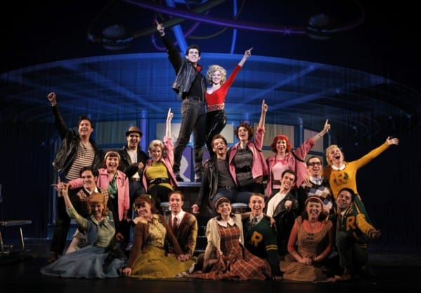 """Matt Nolan as """"Danny"""" and Alyssa Herrera as """"Sandy"""" (center), and the company of Grease, perform the finale of GREASE, coming to  Broadway San Jose."""