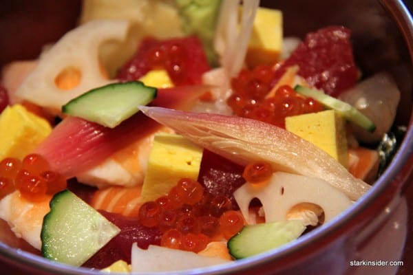 Morimoto's Chirashi comes in a deep red bowl. You can eat it with chopsticks, but I found the use of a long spoon much more satisfying.