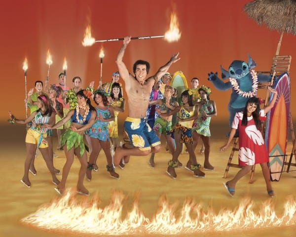 Lilo (bottom right) and Stitch (right back) celebrate a  Hawiian luau with David (jumping, center) in  Disney on Ice presents Let's Celebrate!