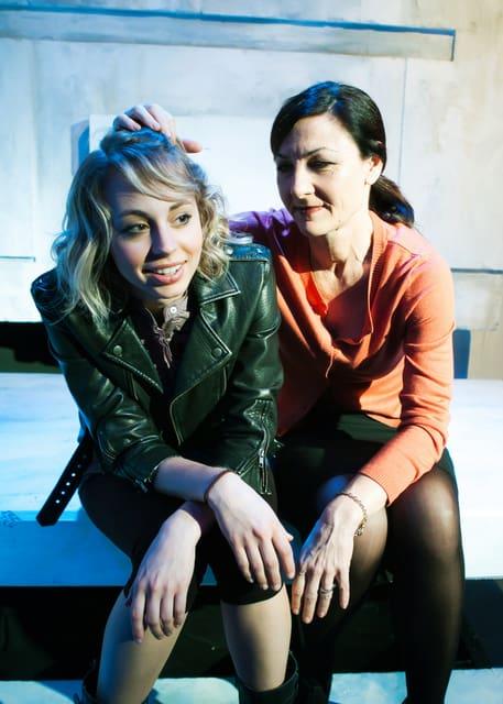 Daughter (Monique Hafen) and Harper (Susi Damilano) bond.