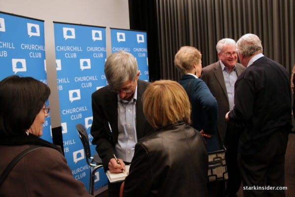 "Bill Davidow signs copies of his new book ""Overconnected"" after the presentation"