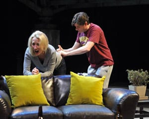 David (Gabriel Marin*) reluctantly gives Hannah (Carrie Paff*) a hormone shot in the National New Play Network Rolling World Premiere of Collapse