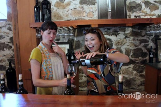 Loni tries her hand at pouring in the Ehlers tasting room.
