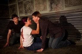 The slain Mercutio (Marilet Martinez, center) is flanked by Benvolio (Seth Thygesen) and Romeo (Michael McDonald) in the Russian Mafia-themed Romeo and Juliet at Impact Theatre