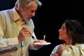 JULIAN LÓPEZ-MORRILLAS as Professor Drake and STACY ROSS as his wife Vera Drake make a wish.