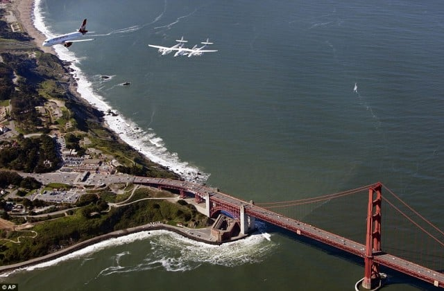WhiteKnightTwo flies over the Golden Gate Bridge enroute to SFO Terminal 2.