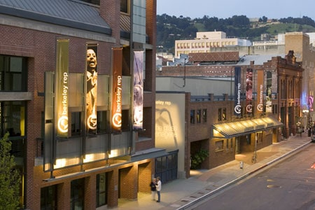 An exterior view of the three-building theatre complex at the Tony Award-winning Berkeley Repertory Theatre. Photographer: Kevin Berne
