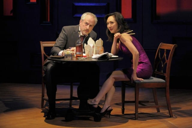 Jack (J. Michael Flynn) and Scarlett (Linda Park) scrutinize the couple standing outside the restaurant in San Jose Rep's world premiere of Love in American Times.