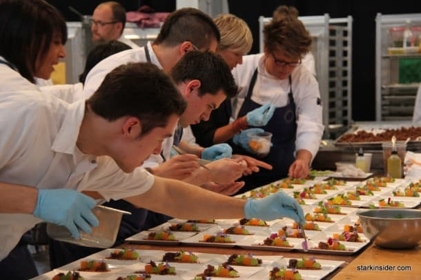 Plating of over 2,700 exquisite dishes requires focus, mastery and stamina. Behind the scenes 10 long lines of plates are staged, each allocated to three master chefs and their creation from their respective restaurants.