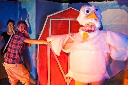 Emory (Charlie Cromer, middle) does a dance routine with his chicken friend Linda (Sarah Coykendall) as the narrator (Cindy Im) looks on in MilkMilkLemonade, a warped tale of innocence lost at Impact Theatre
