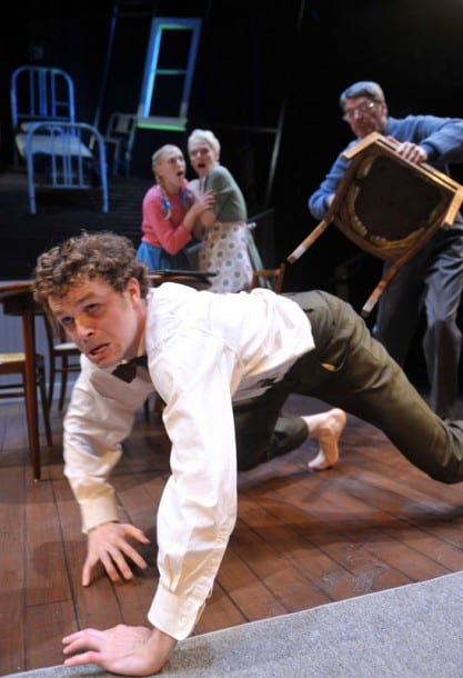 Gregor (front, Alexander Crowther) runs from his father (r. Allen McKelvey*) as his sister Grete and mother (c. l-r, Megan Trout, Madeline H.D. Brown) look on
