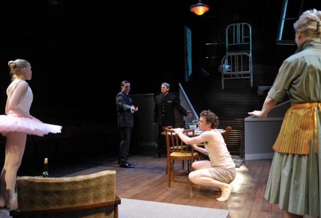 Gregor (c. Alexander Crowther) makes an unwelcome appearance during Grete's (l, Megan Trout) performance, angering Mr. Fisher, Father, and Mother (l-r, Patrick Jones,* Allen McKelvey,* Madeline H.D. Brown) in Metamorphosis