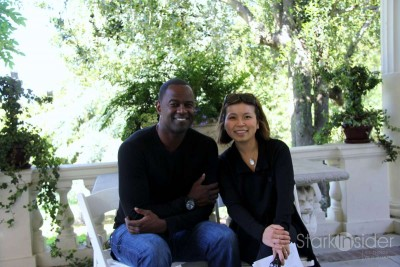 Brian McKnight and Loni Kao Stark post after a pre-show interview.