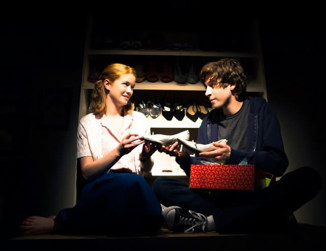 Sherri (Melissa Quine) and Zack (Jeremy Kahn) share truths in his mothers shoe closet.