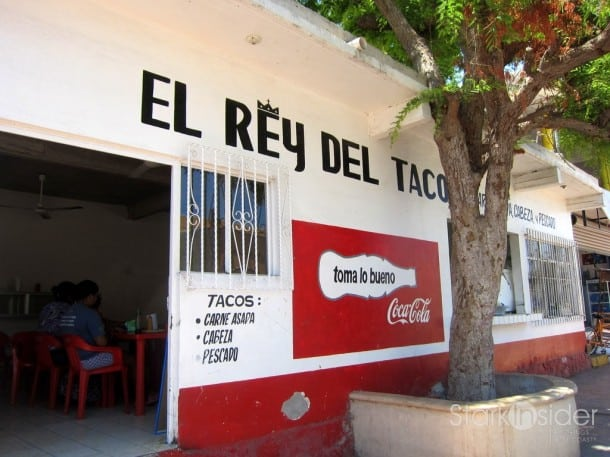 Front of El Rey Del Taco. Its distinctive red and white building is hard to miss. It does seem that Coca Cola commissioned Andy Warhol to paint this building.