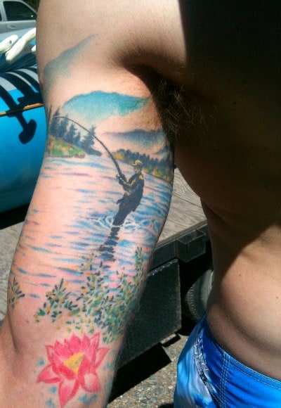 "Our 10,000 waves guide gorgeous ""fly fishing tat"""
